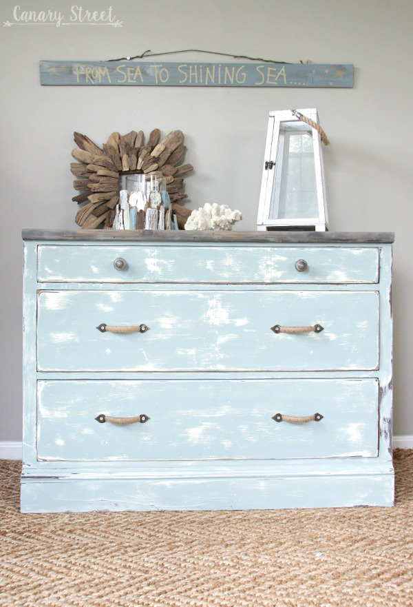 Weathered Coastal Dresser makeover.  Painted with Annie Sloan chalk paint and General Finishes stain.  Full tutorial  https://canarystreetcrafts.com/