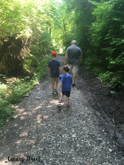 Sam, Max and my dad on a geocaching adventure.