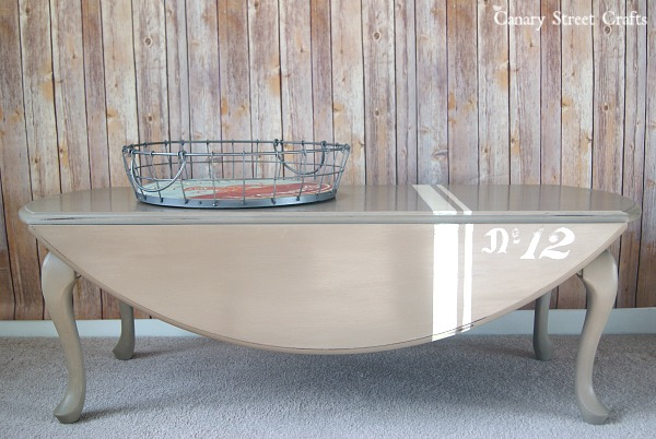 Drop leaf coffee table with a grain sack stripe. Painted with Annie Sloan chalk paint.