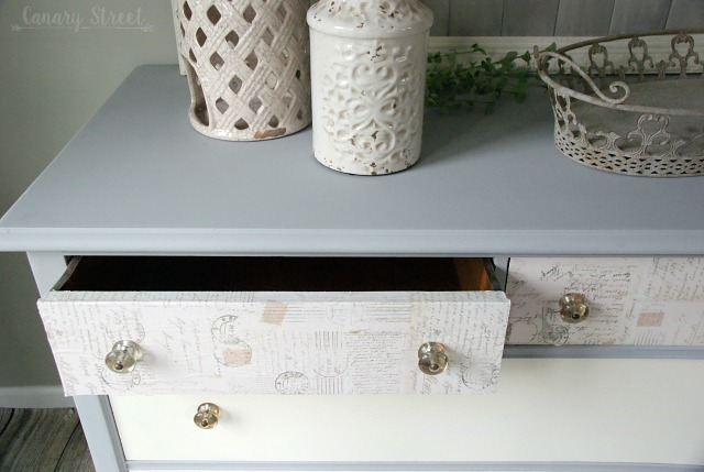 Pretty grey and white dresser makeover.  The top drawers are decoupaged.  Full tutorial plus lots more furniture makeovers and painting tips.  http://canarystreetcrafts.com/