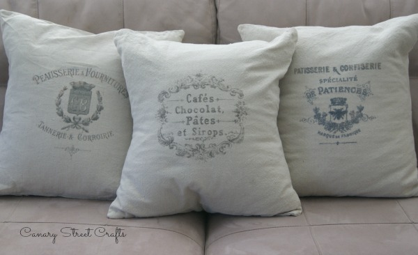 DIY French Grain Sack Pillows.  4 pillow covers for under $20 using inexpensive drop cloth from the hardware store. canarystreetcrafts.com