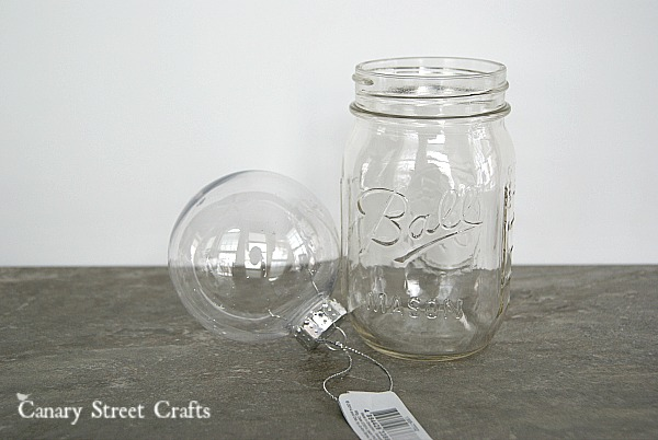 DIY Mason Jar Snowman. Made using a mason jar and a clear ornament! {Canary Street Crafts}