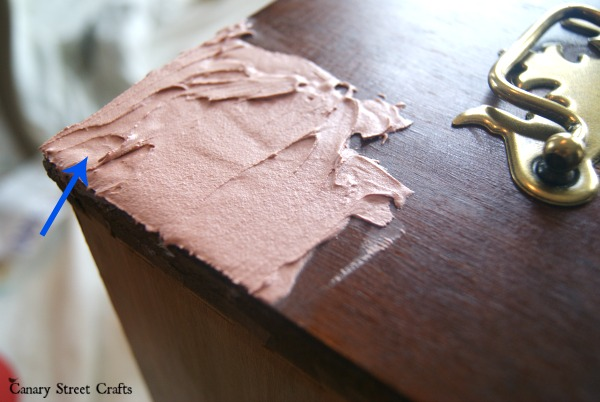 How to easily fix damaged veneer on furniture using Bondo.