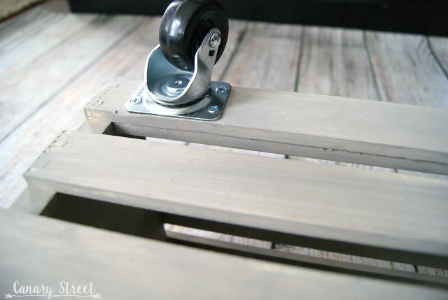 Wood Crate Storage Ottoman. Easily make a rolling wood crate storage ottoman. Full tutorial https://canarystreetcrafts.com/