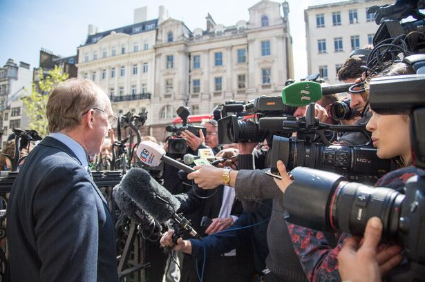 The media ask questions of Cllr Peter Golds outside the High Court