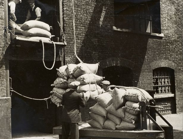 Sugar loaded on to electric truck for storage in warehouse, 1930s © PLA Collection / Museum Of London