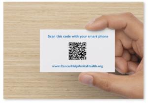 Hand holding back of Amita Health CancerHelp Online business card