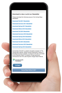 Hand holding iPhone showing the bottom of Essentia Health's Newsletter webpage in CancerHelp Online