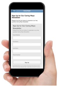 Hand holding iPhone showing the newsletter sign up form of Essentia Health's Newsletter webpage in CancerHelp Online