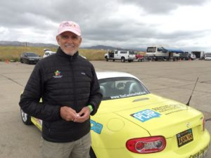 picture of Cancer Journeys Foundation president Robert Hess with his MX-5 Miata that he will drive on the 2018 Tour de USA