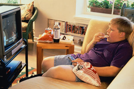 heavy kid on couch watching TV