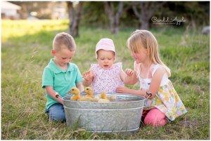 Three Children Watching Ducks Splashing