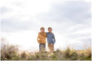 Two brothers standing on a mountaintop