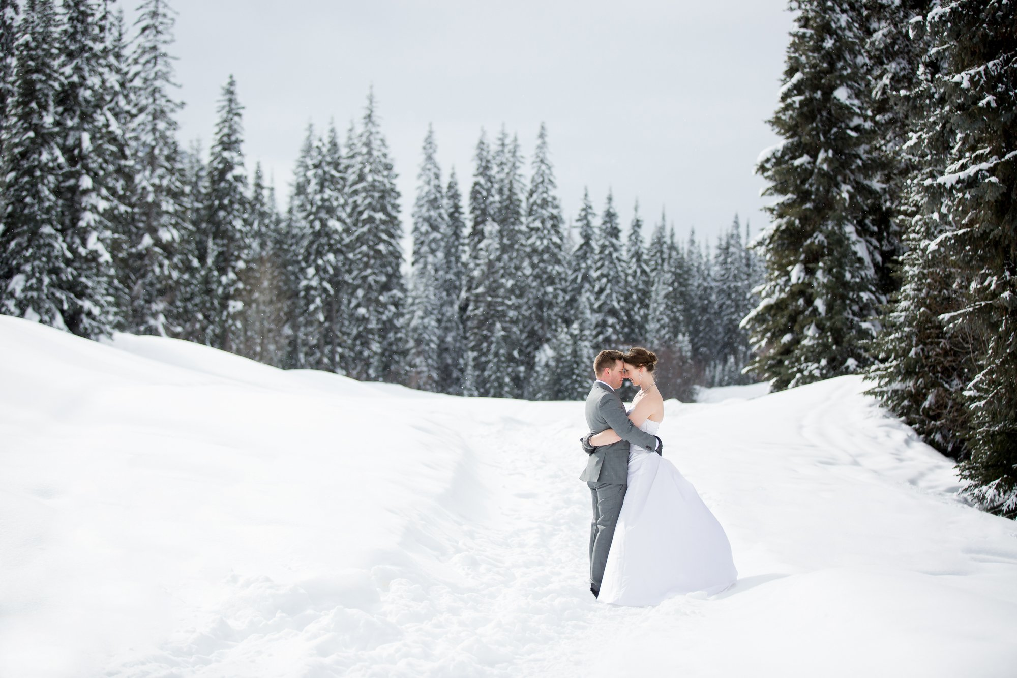 A couple hugging on their wintery wedding day