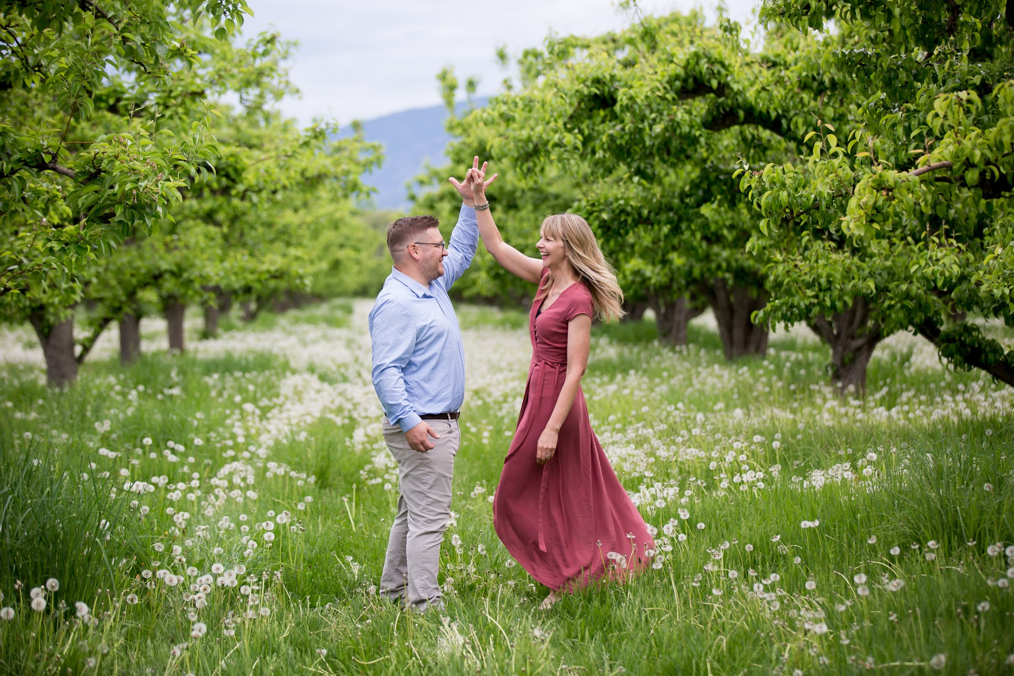 A couple dancing in an orchard