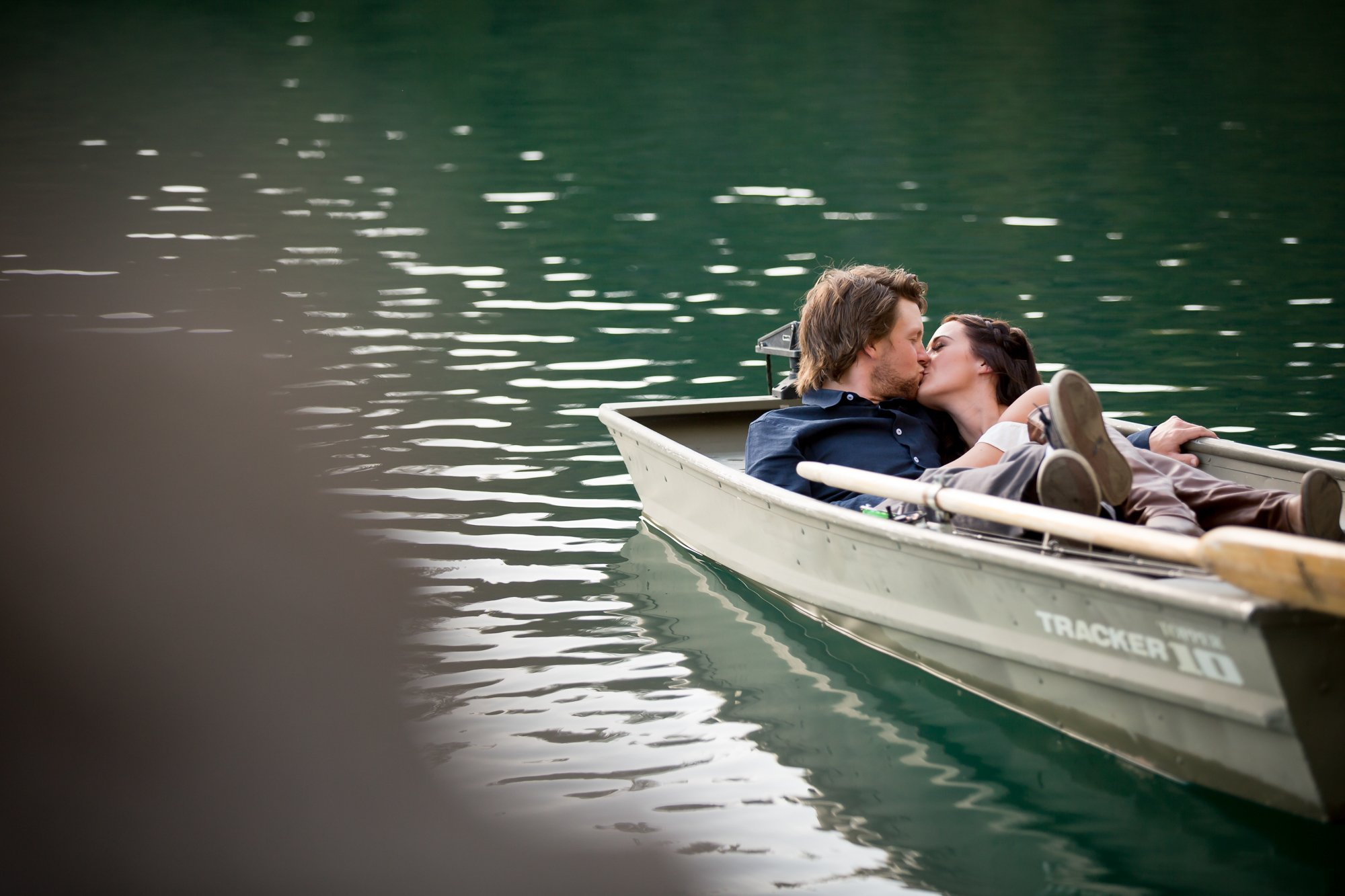 A couple kissing in a boat