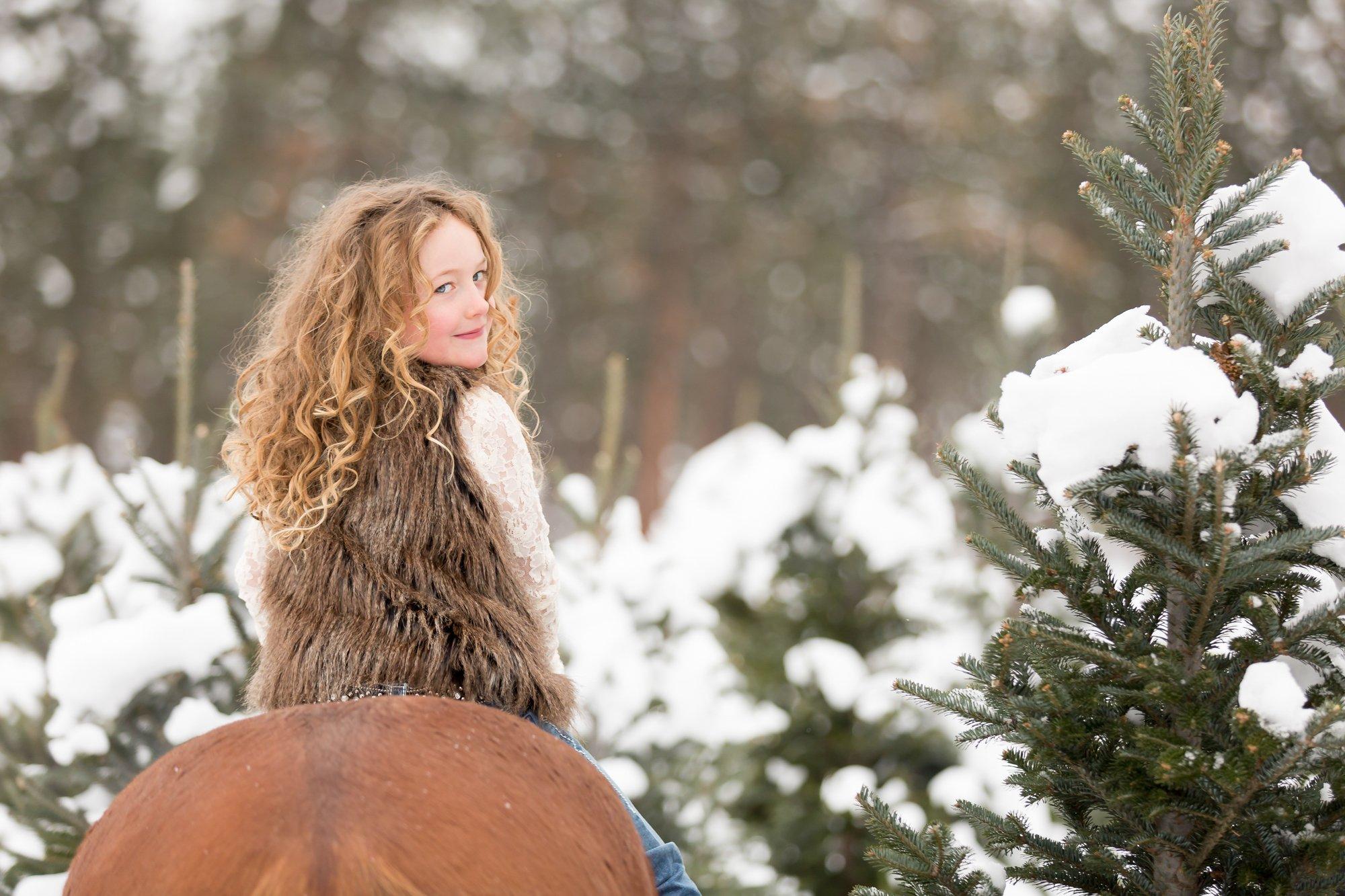 A girl sitting on her horse bareback