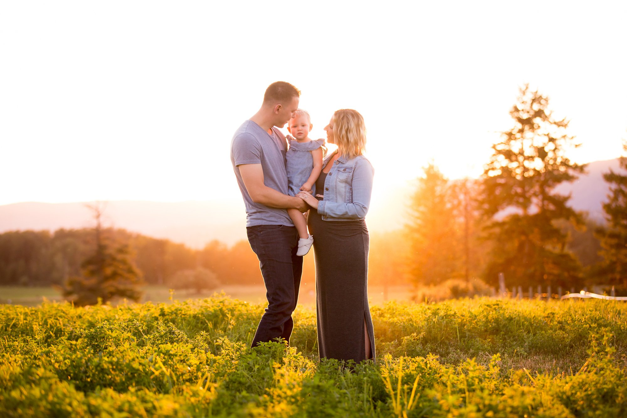 A family stadning together at golden hour