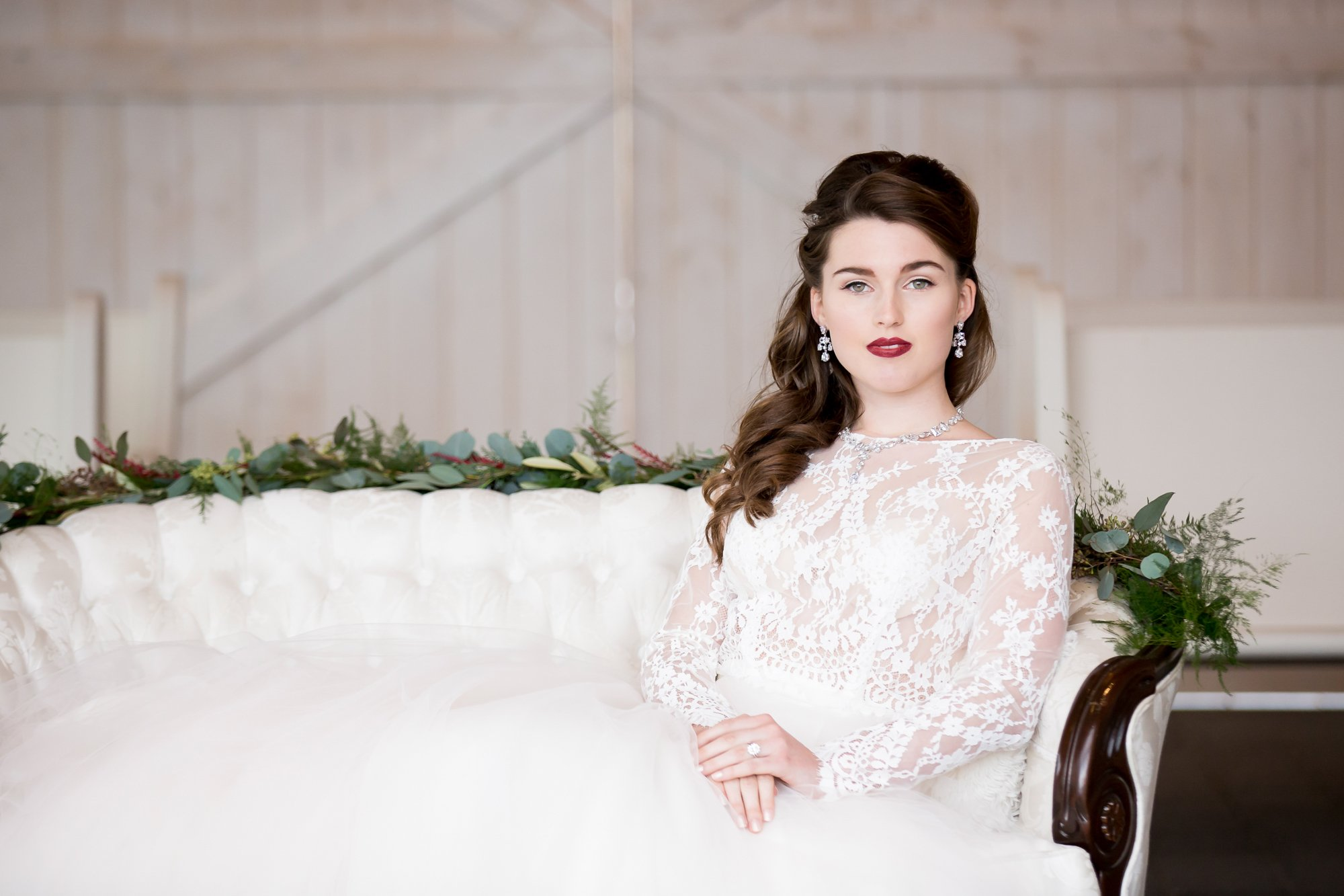 A bride sitting on a white couch