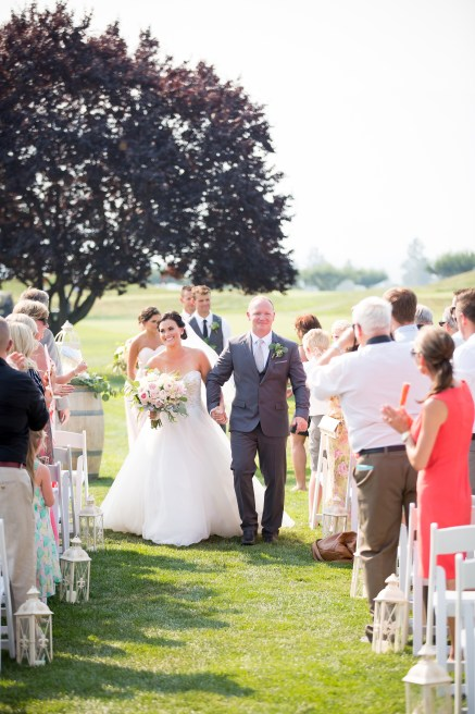 A couple duting their ceremony recessional