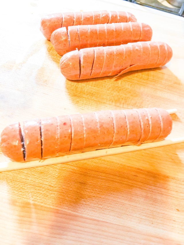 For a nicer presentation and a crispier cook, hasselback the sausages.  This means slicing the sausages but not all the way through. I save unused takeout chopsticks and use them as a guide to prevent me from cutting all the way through.  You could also butterfly the sausages or simply leave them whole if you prefer.