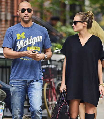 Retired New York Yankees shortstop Derek Jeter and girlfriend Hannah Davis (in a trendy oversized dress and over the knee boots) in New York City! Photo credit: Pacific Coast News. Image courtesy of People.com