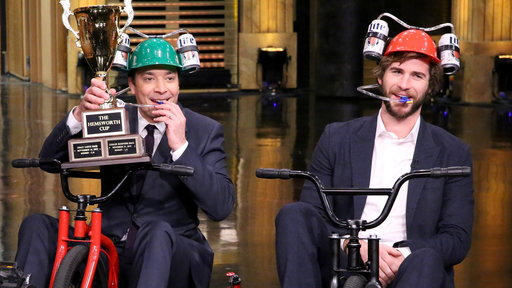 """Giant Tricycle Race between Liam Hemsworth and Jimmy Fallon. Watch the video below to see who won the Hemsworth Cup on the Friday, November 14th episode of """"The Tonight Show Starring Jimmy Fallon""""!"""