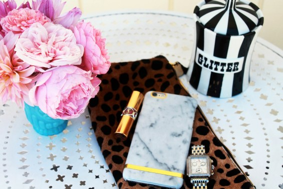 Candace Rose Love my marble iPhone 6s plus case for fall! Also in photo: Michele watch, YSL lipstick, Clare V leopard print clutch, Jonathan Adler Glitter container. candie anderson