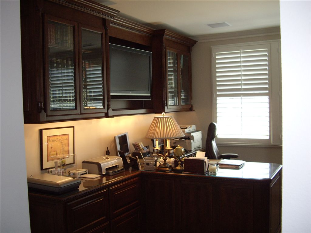 Custom home office design for a stock broker with a built