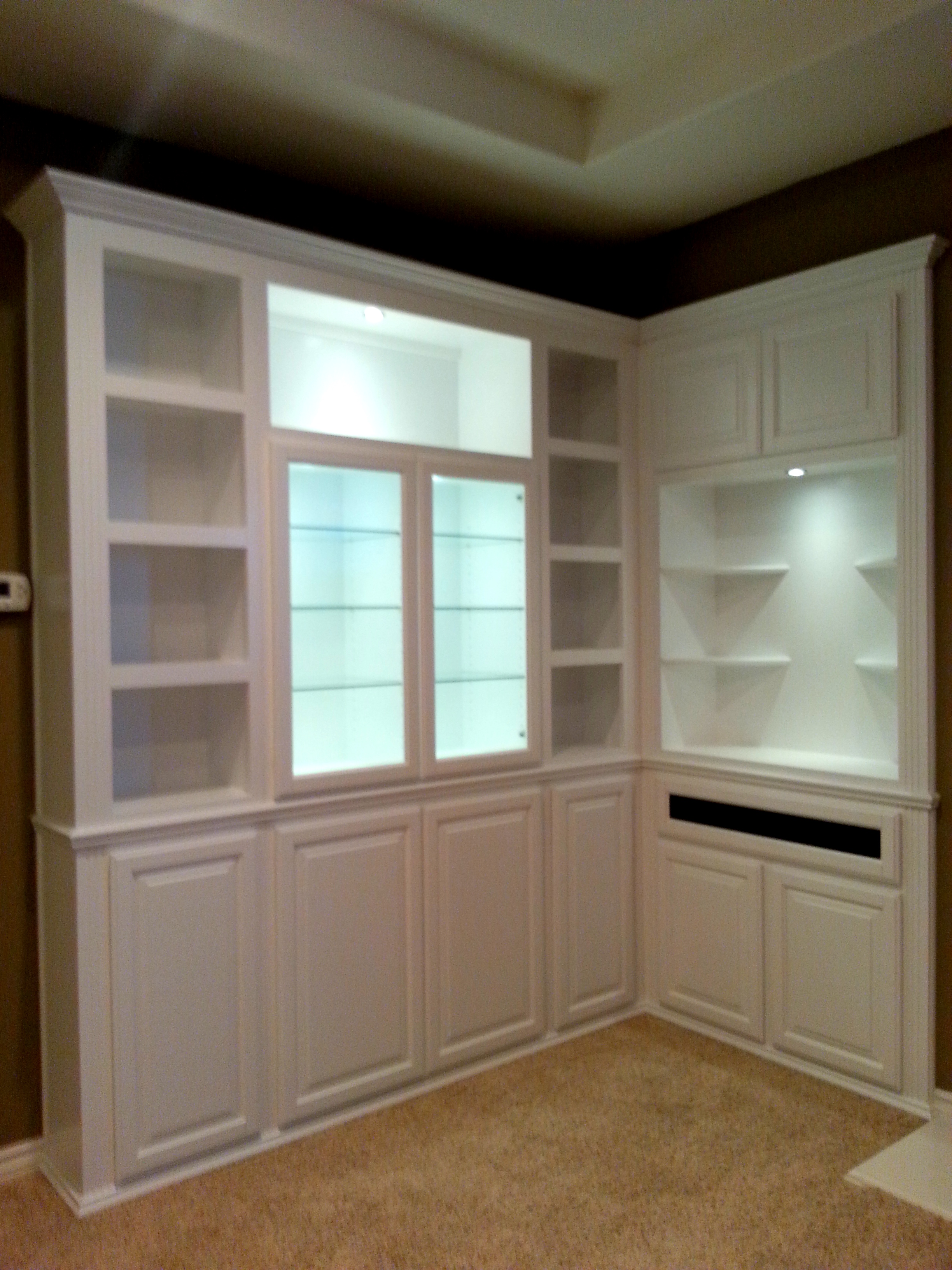 Built in white corner cabinets  C  L Design Specialists Inc