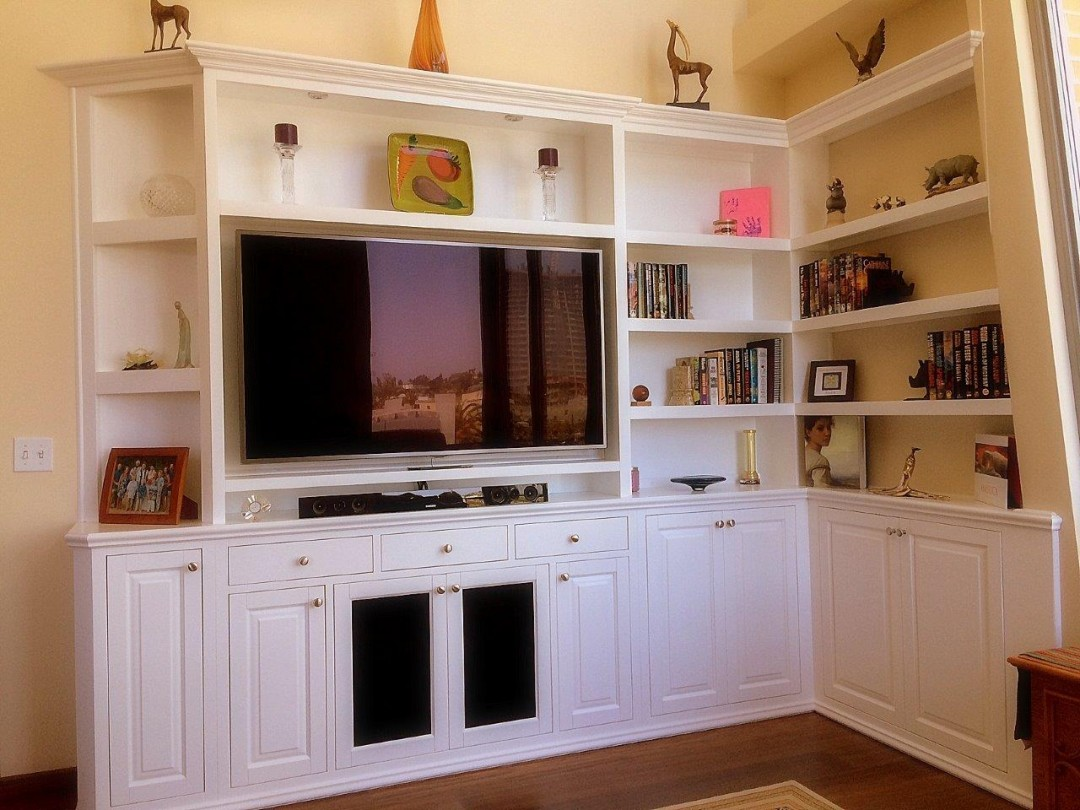Built in white entertainment center  C  L Design Specialists Inc