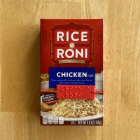 a Rice a Roni braille label on a box held on by a replaceable elastic