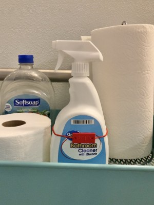 tile cleaner bottle on a bathroom supply cart wearing a CanDo box label
