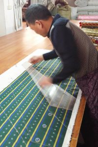 Part of the tie manufacturing process: cutting ties into shape