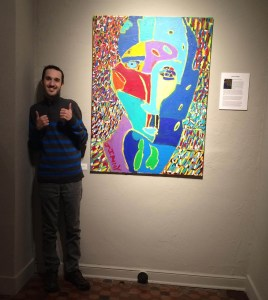 Jimmy Reagan giving thumbs up in front of his painting