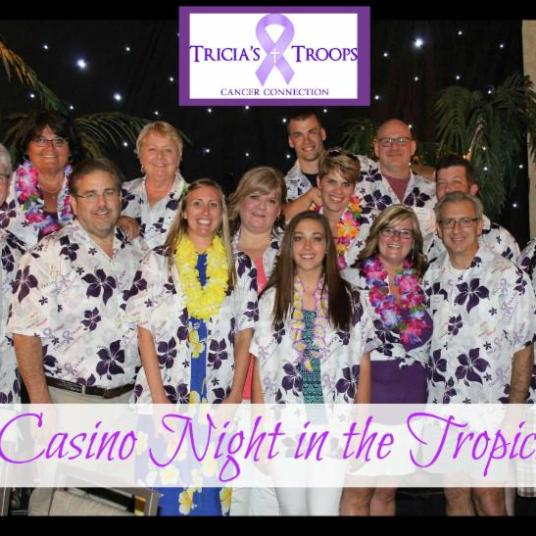Photos of smiling men and women wearing purple and white custom Aloha shirts