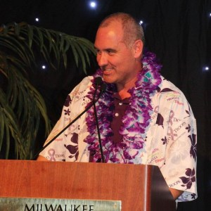 Bill Wright wears a custom made Tricia's Troops Hawaiian shirt with purple flowers