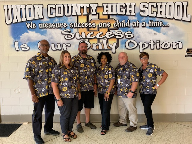 Union County High School teachers in their custom Hawaiian shirts