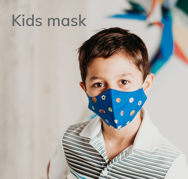 child wearing a kid's size blue sports themed cotton face mask