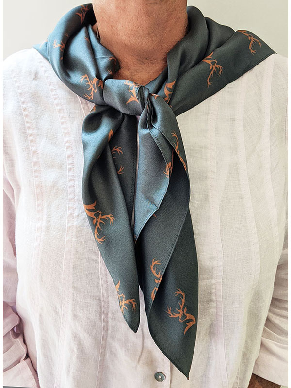 person wearing a custom gray square scarf with deer pattern