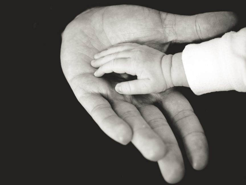 adult hand baby hand, doula