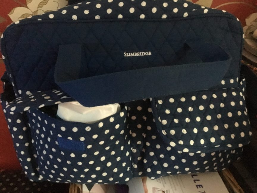 changing a newborn, Blue polka dot change bag