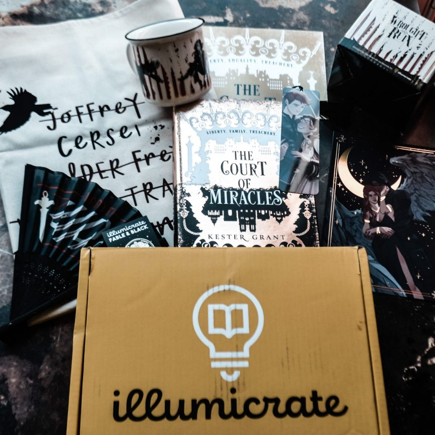 unboxing the june in the shadows illumicrate book box photo shows included items. a game of thrones tea towel, a vicious mug, the court of miracles book, a pin, a nevernight fan.