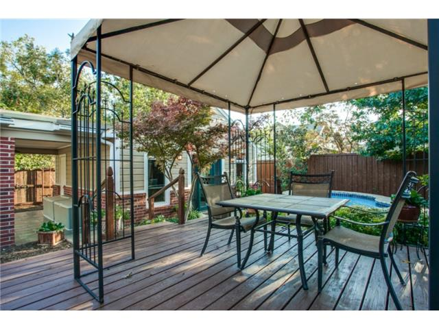 Beautiful deck in the serene backyard.