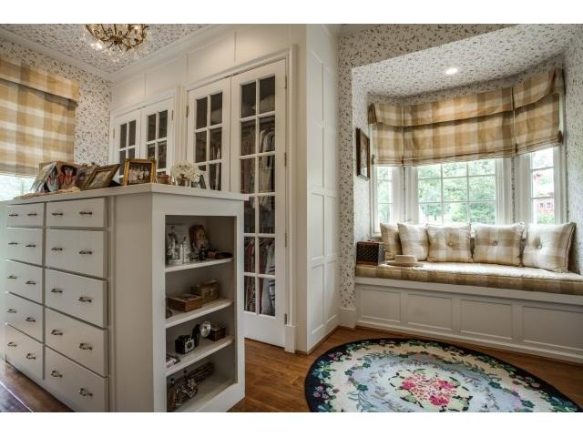 """""""her"""" separate closet with beautiful mill work,drawers, bench se"""