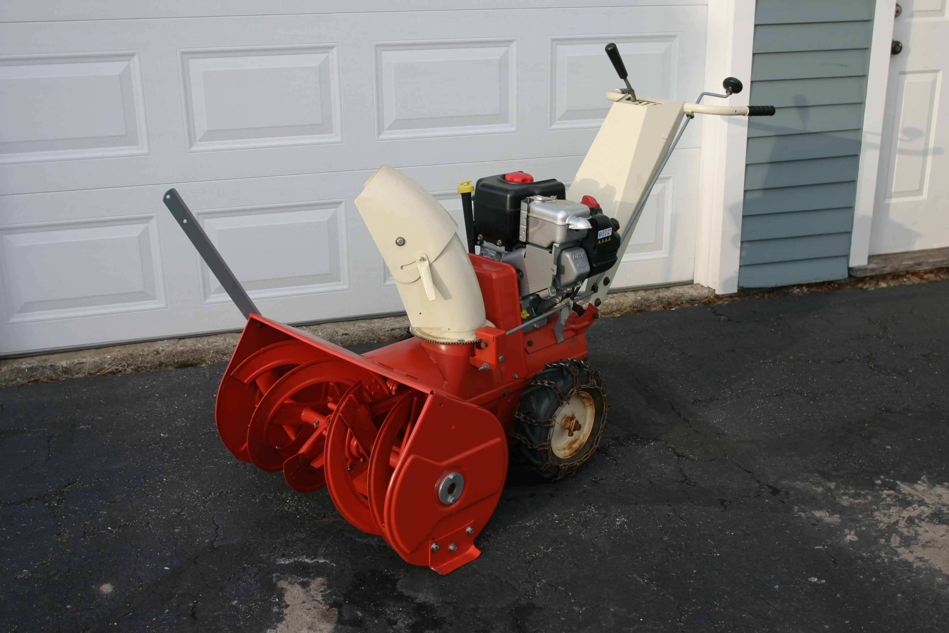 Red and white snowblower