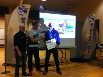 Olympic gold medallist Etienne Stott presents Trevor Foster from Erne Paddlers with the clubs Clubmark Certificate