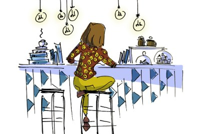 Girl reading a book and drinking coffee at Minoa bookstore