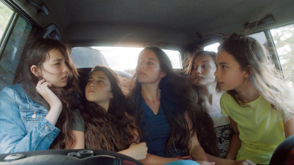 Mustang's five sisters in a car