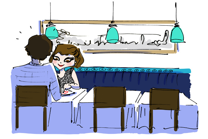 Girl eats at Yeni Lokanta